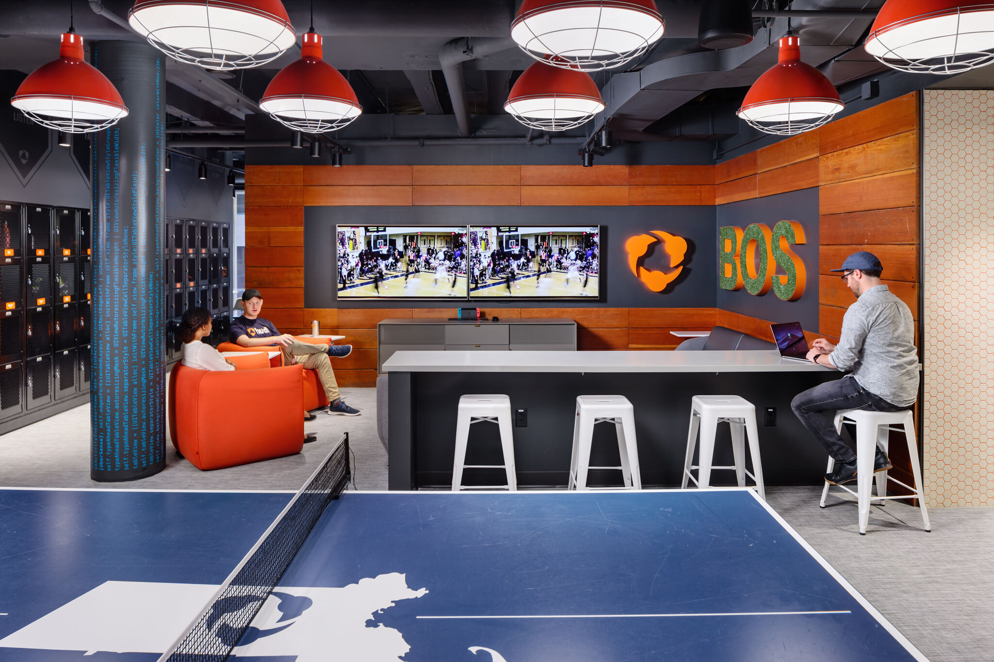 health_office_spotlight_HUDL_office_common_space_tvs